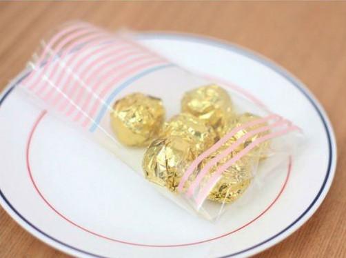 упаковка конфет в целлофановый пакет, фото
