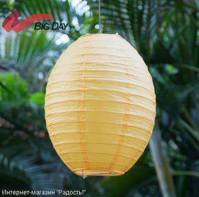 Жёлтый бумажный китайский фонарик овальной формы