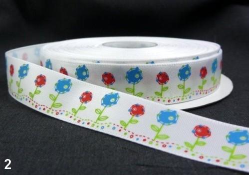 9.91: Белая декоративная атласная лента с цветочным рисунком: синие и красные цветы. Ширина ленты - 16 мм