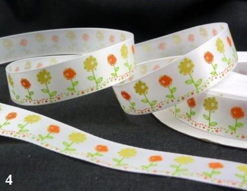 9.91: Белая атласная лента с цветочным рисунком: жёлтые и оранжевые цветочки. Ширина ленты - 16 мм