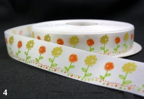 9.91: Белая атласная лента с цветочным рисунком: жёлтые и оранжевые цветы. Ширина ленты - 16 мм