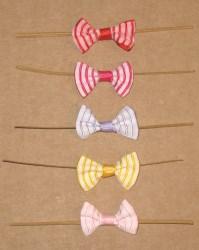 твисты с бантами из репсовой ленты: бело-красный, малиново-белый, сиреневый, бело-жёлтый и бело-розовый